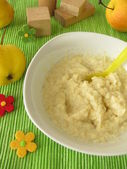 Millet porridge with apple mash for babies and small children — Stock Photo
