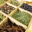 Spice box with pepper, marjoram, coriander and other spices — Stock Photo
