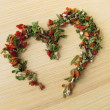 Heart of herb pepper - Stock Photo