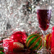 Stock Photo: Wine glass, Christmas-tree decorations and candle