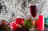 Wine glass, Christmas-tree decorations and candle — Stock Photo