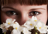 The girl with white violets — Stock Photo