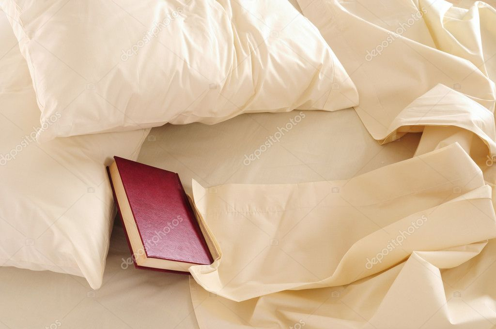 Top view of a messy bed.  Stock Photo #9117100