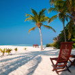 Beach chairs on a perfect tropical island — Stok fotoğraf