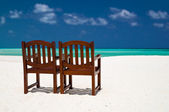 Pair of chairs on a tropical beach — Stock Photo