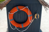 Life buoy on a beach hut — Stock Photo