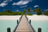 Jetty leading to a tropical island — 图库照片