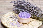 Aromatic bath salt and dry lavender flowers — Stock Photo