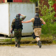 Stock Photo: Soldier Escorting captured combatant