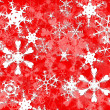 Bright White christmas snowflakes on red — Foto de Stock