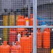 Stock Photo: Secured Gas Canisters in Fenced Area