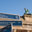 Direction Sign by Brandenburg Gate - Stock Photo