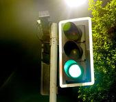 Traffic Lights Green Go near a Bright Lamp — Stock Photo