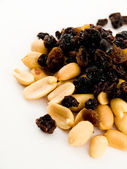 Stack Pile of Peanuts and Raisins on White — Stock Photo