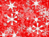 Bright White christmas snowflakes on red — Stock Photo