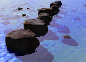 Row of Stepping Stones in a Blue Ocean River — Stock Photo