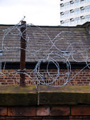Barbed Wire Protecting House — Stock Photo