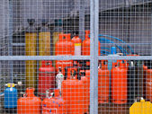 Secured Gas Canisters in Fenced Area — Stock Photo