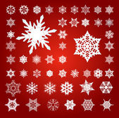Collection of 50 Fifty Snowflakes on Red — Stock Photo