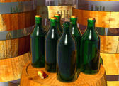 Bottles of Wine on Barrels — Stock Photo