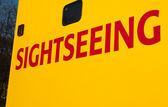 Sightseeing writing on Tourist Tour Bus — Stock Photo