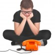 Sad boy is waiting for expected phonecall — Stock Photo