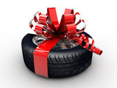 Tyre with ribbon — Stock Photo