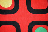 Textile background red black yellow green — Stock Photo