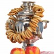 Russian samovar with bagels and apples - Stock Photo