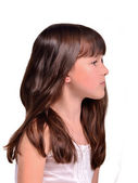 Profile portrait of little girl with long beautiful hair — Stock Photo