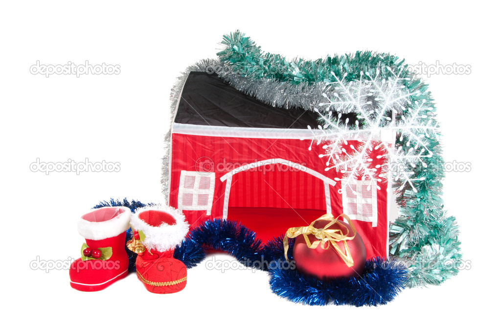 Santa's Boots, Christmas ball, garland and a house — Stock Photo #8289490