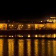 The Prague National Theater and the Vlava river at night — Stock Photo