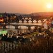 Panoramic view on Charles bridge and sunset Prague lights. Bohemia, Czech R - Stock Photo
