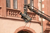 Professional video filming in city center in European town — Stock Photo