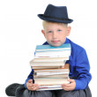 Boy with a pile of books — Stock Photo