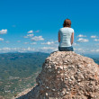 Girl on a cliff looking at view — Stock Photo