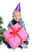 Little boy with Christmas present near new year tree — Stock Photo