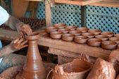 Potter's hands, creating an earthen jar on the circle — Стоковое фото