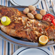 Roasted fish on the plate - Stock Photo