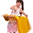 Dangerous housework - little girl ironing her dress — Stock Photo