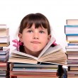 Stock Photo: Portrait of cute girl sitting among stacks of books