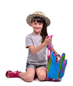 Little girl packing her staff to go to vacation — Stock Photo
