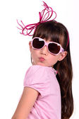 Portrait of lovely girl wearing pink blowing a kiss — Stock Photo