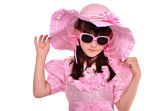 Portrait of lovely girl wearing pink dress, hat and glasses — Stock Photo