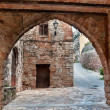 Street with an arch, Collbato, Spain — Stock Photo