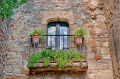 Balcony with flowers, Peratallada, Spain — Stock Photo