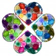 Kaleidoscope Design of Flower hearts (ladies barrettes) isolated on white b — Stock Photo