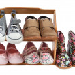 Stock Photo: Shelf of children shoes for all occasions isolated on white background