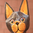 Portrait of wooden hand painted cat statuette - Stock Photo