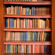 Old bookshelf in ancient library — Stock Photo